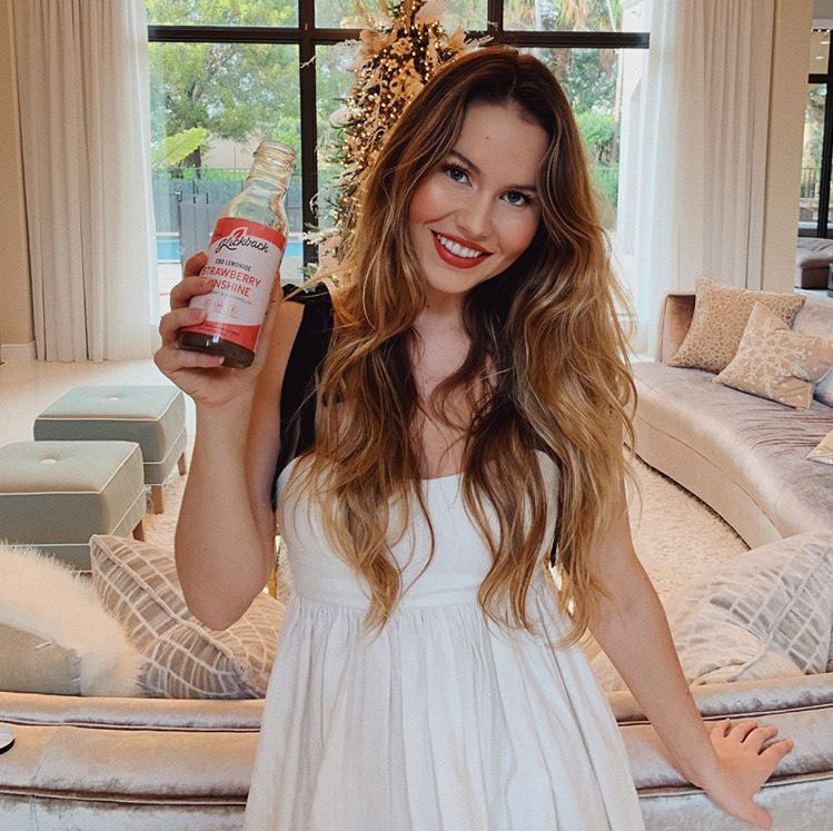 Woman holding CBD drink in Los Angeles